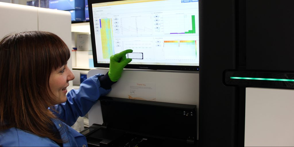 Researcger in our genomics core comparing samples to a screen