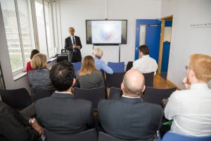 Professor Ajay Shah presenting to a group of MPs on a visit to the St Thomas' CRF
