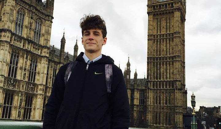 theo Knott in front of the Houses of Parliament
