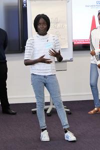 Student Destiny Boka Batesa presenting what she learned during the week