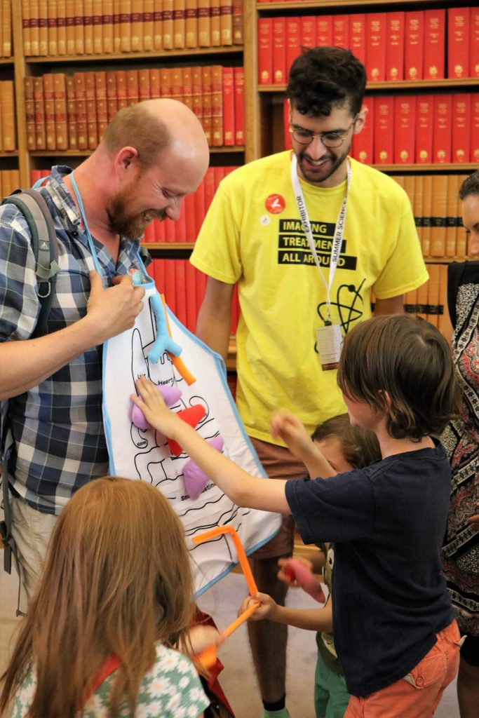 Family and demonstrator at Summer Science Exhibition