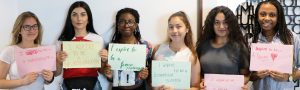 KHP Summer School students with posters about their aspiration