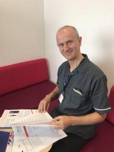 Krzysztof Rutkowski, a research nurse, looking through files