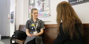 Children's research nurse Alyssia talkig to a patient who is taking part in a study