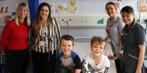 Dr Melita Irving and her team, with patients Sam and Jack