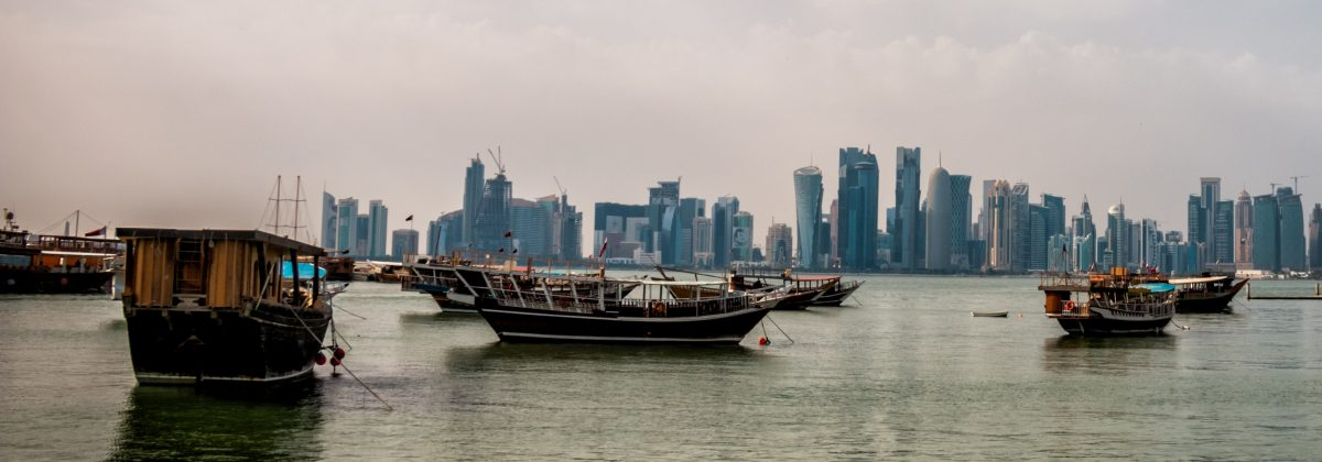 Image of the Qatari skyline across water, with boats in the foreground