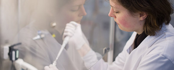 researcher pipetting