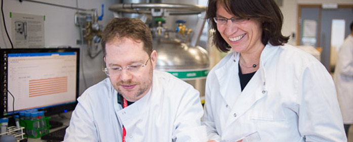 researchers in flow cytometry lab