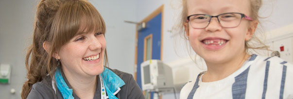 A research nurse and patient smiling