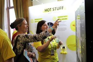 Member of the public talking to a demonstrator about radiotherapy at Summer Science Exhibition