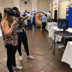 Visitors testing out virtual reality headsets at International clinical Trials day 2019
