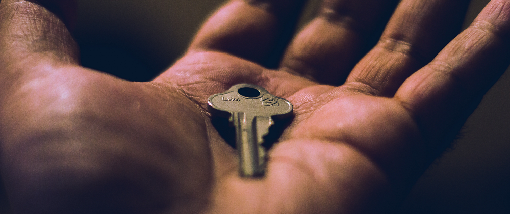 a key in a person's hand
