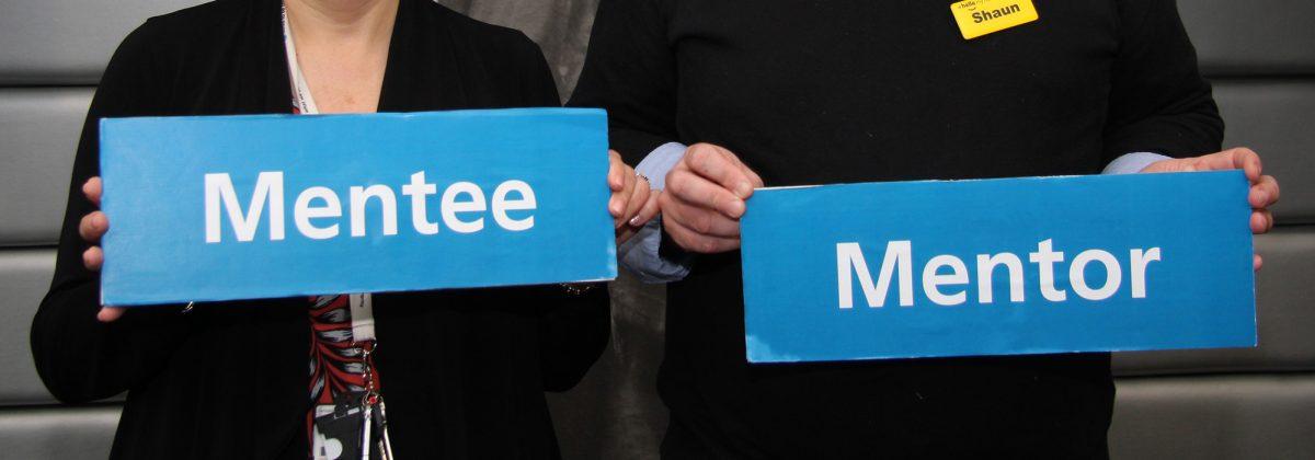 Bernadette Cronin, Shaun Cochrane holding mentor and mentee signs