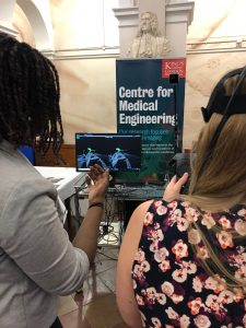members of the public try out VR technology for ICTD 2019