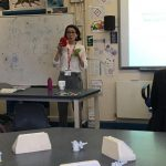 Flavia Flaviani with cell props in classroom