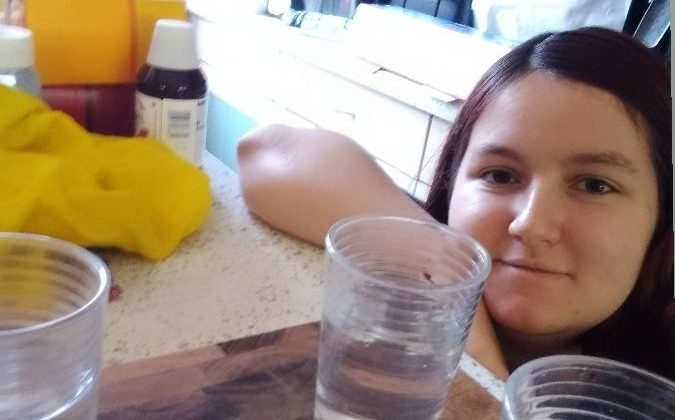 Image of a Summer School student with glasses of water